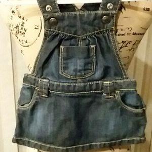 Girls Infant bib skirt w/ruffled back.